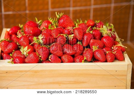 Ripe Strawberries Ready For Eating In Wooden Boxes. Red Ripe Strawberries Closeup. Selective Focus.