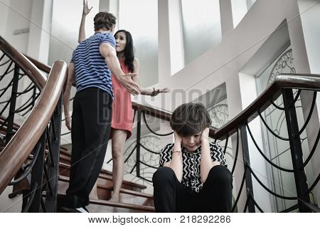 The concept of parental family quarrels Young Couple Parents are fighting in front of children.
