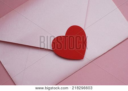 Close Up Pink Envelope and Red Heart