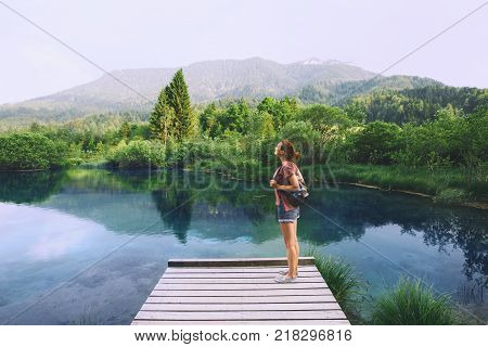 Young woman breath on the nature background. Travel Freedom Lifestyle concept. Slovenia Europe.