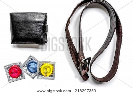 male contraception for safe sex with condoms and wallet on white desk background top view
