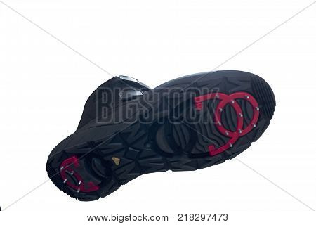 anti slip shoe close up on a white wooden background