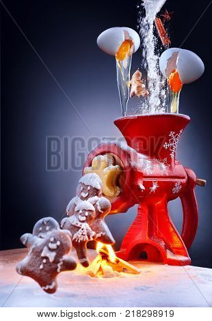 Gingerbread Man Cookies Get Out From From Fairy Christmas Meat Grinder And Jump Through The Fire. In
