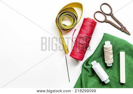 sewing hobby with tools, thread, scissors white desk background top view space for text