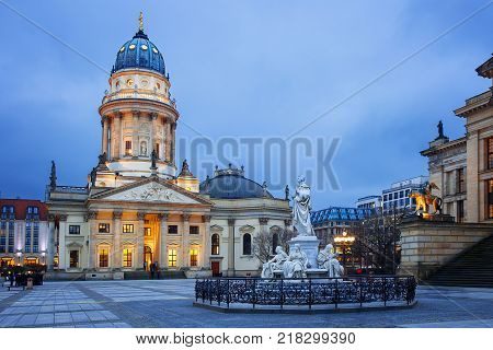 New Church on Gendarmenmarkt, with the monument of Friedrich Schiller in the foreground. Berlin, Germany