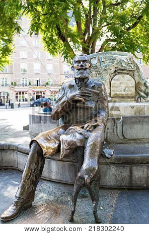 BRUSSELS, BELGIUM - JUNE 04, 2017: Bronze monument to the burgomaster of Brussels Charles Buls and his dog. Located on the Agora Grasmarkt square in central Brussels, Belgium.