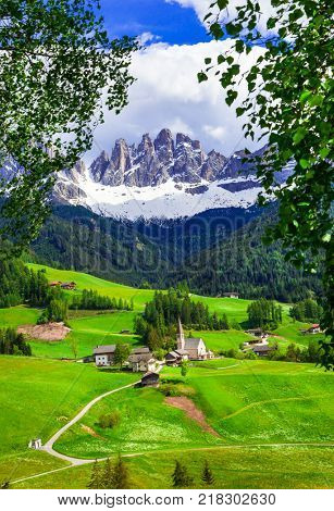Alpine scenery - Dolomites mountains and traditional villages. Val di Funes, Italy