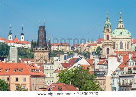 Lesser Town Bridge Towers and St. Nicholas Church at the Mala Strana in Prague, Czech Republic, in the morning