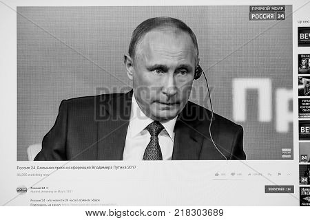 PARIS FRANCE - DEC 14 2017: Youtube live channel of Rossiya RTR the Russian President Vladimir Putin give final media Q&A before March election - listening to foreign journalists translation