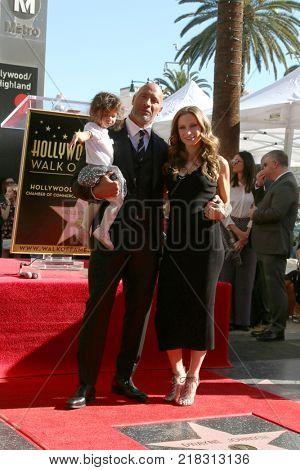 LOS ANGELES - DEC 13:  Dwayne Johnson, Jasmine Johnson, Lauren Hashian at the Dwayne Johnson Star Ceremony on the Hollywood Walk of Fame on December 13, 2017 in Los Angeles, CA