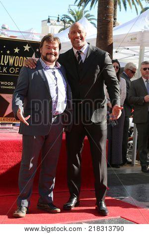 LOS ANGELES - DEC 13:  Jack Black, Dwayne Johnson at the Dwayne Johnson Star Ceremony on the Hollywood Walk of Fame on December 13, 2017 in Los Angeles, CA