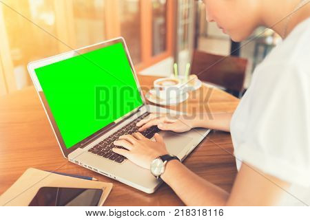 Female working on laptop in a cafe. woman using laptop in home. using laptop internet. hand using laptop in coffe shop. green screen.  Business entrepreneur asian girl working online on laptop in cafe. business entrepreneur asian using laptop in home.