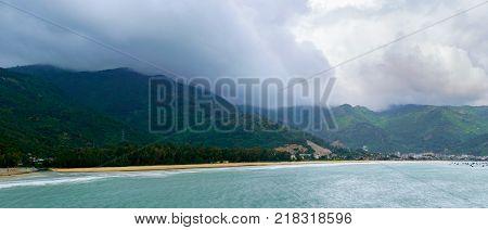 Beautiful long sandy beach at Asian country. Cloudy weather, rain season
