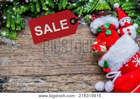 Merry Christmas and Happy New Year winter season with snow and decoration. Price tag for sale on Boxing day.