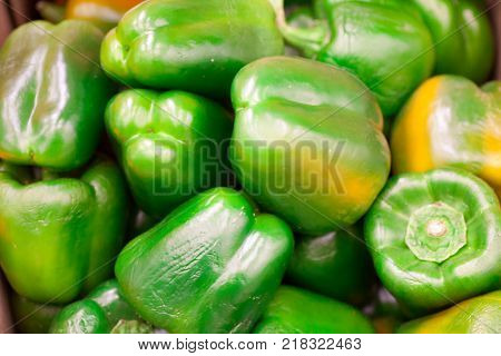 colorful bell peppers, natural background Sweet pepper on shop window for sale on the market top view