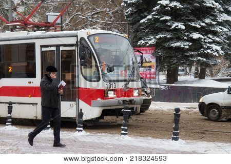 NIZHNY NOVGOROD, RUSSIA - NOVEMBER 07, 2016: The city tram 71-407 (manufactured by Uraltransmash). This is a Russian passenger four-axle high-floor tram car with asynchronous traction electric motor.
