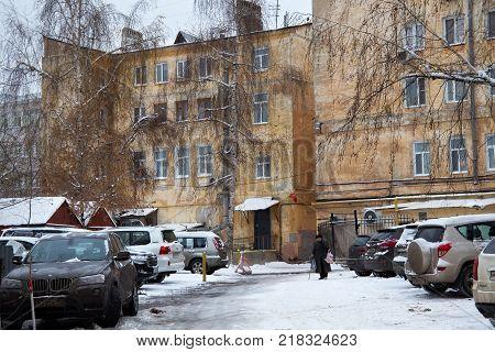 NIZHNY NOVGOROD, RUSSIA - NOVEMBER 07, 2016: The old yard with shabby apartment buildings on Bolshaya Pokrovskaya Street in the historic center of Nizhny Novgorod.