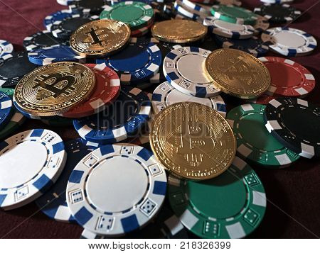 Bitcoin coins and poker chips. New virtual and real currency. The concept of replacement bitcoin in all forms of payment.