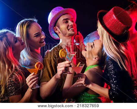 Dance party with group people dancing. How to be an alpha male at a club. Women and confident casual smiling man have fun in night club. Seduce boozy woman cuddles up guy .