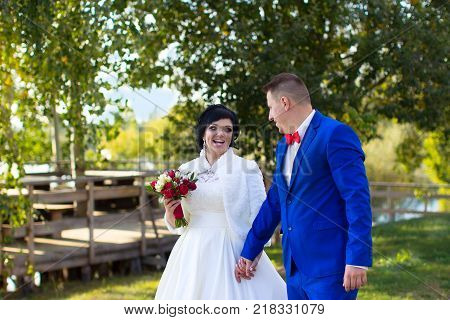 Belarus Gomel September 29 2017 Wedding Feast.The bride and groom on a wedding walk. The bride and groom with a bouquet