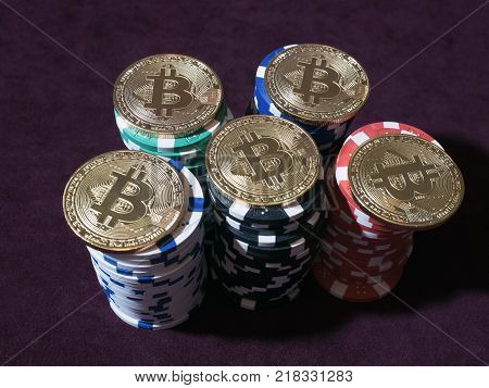 Bitcoin coins on poker chips. New virtual and real currency. The concept of replacement bitcoin in all forms of payment.