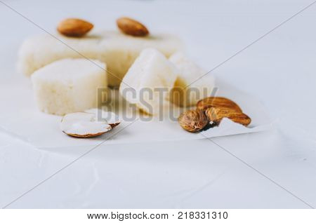 Marzipan with nuts on white rustic kitchen table