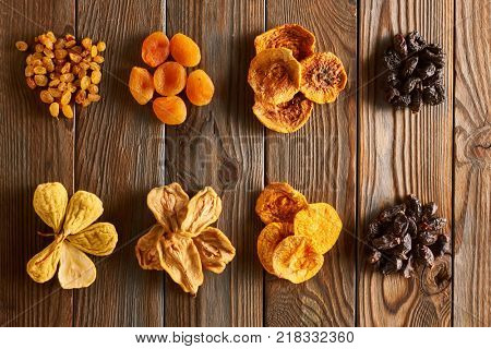 Dried fruits on vintage rustic wooden background
