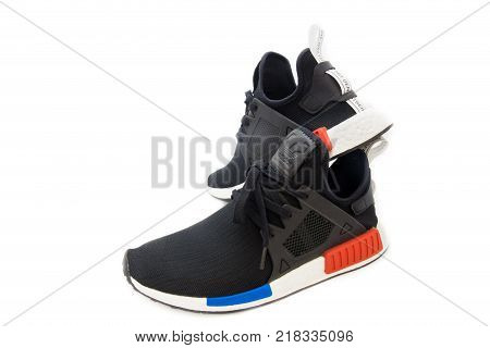 BANGKOK, THAILAND - AUGUST 11, 2017: Adidas NMD XR1 OG shoes isolated on white background in studio most popular fashion in year 2017, process color.