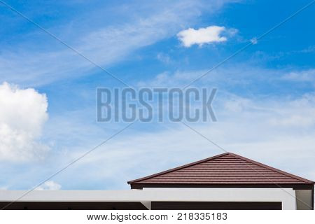 Roof of modern house with blue sky background. Copy space background