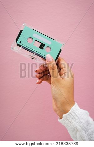 Closeup of hand holding design space cassette tape