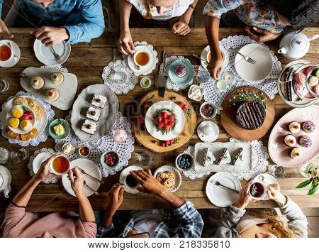 Friends Gathering Together at a Tea Party