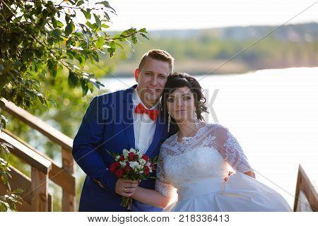 Belarus Gomel September 29 2017 Wedding Feast.Portrait of the bride and groom in nature.