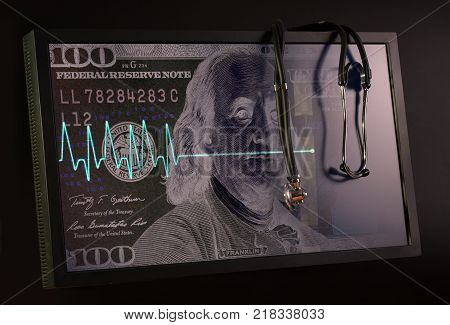 Fading cardiogram and stethoscope against the background of the US dollar