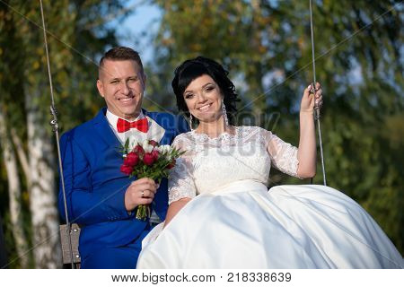 2017 Wedding Feast.The bride and groom on the swing.The bride and groom on a walk