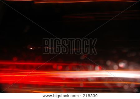 Red And White Streaks Against A Black Background