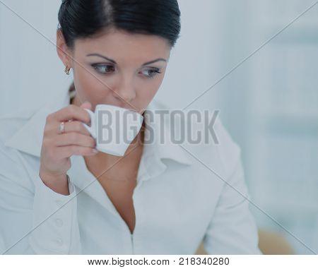 Business woman drink cofee
