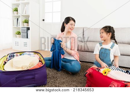 Little Girl Packing Travel Luggage Suitcase