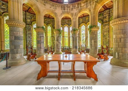 Argyll, Scotland, United Kingdom - June 1, 2015: wooden altar with marble columns of Saint Conan's Kirk gothic church, on Loch Awe lake in Argyll town of Scotland in Scottish highlands.