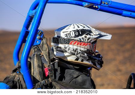 Merzouga Morocco - February 25 2016: Man riding blue RZR800 buggy car in desert and having fun. Merzouga is famous for its dunes the highest in Morocco.