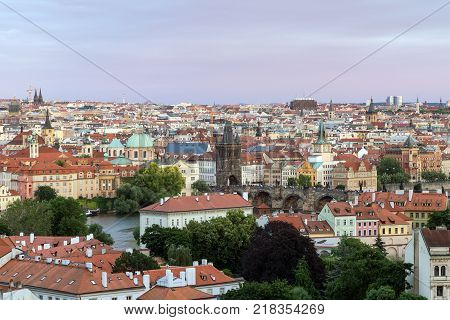 View of buildings at the Mala Strana (Lesser Town) and Old Town districts and beyond in Prague, Czech Republic.