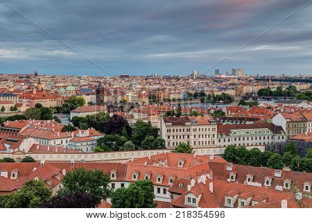 View of buildings at Mala Strana (Lesser Town), Old Town and beyond in Prague, Czech Republic, viewed slightly from above in the early evening.