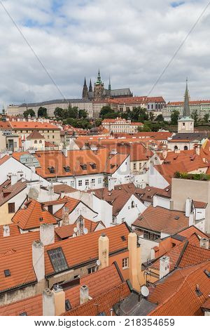 View of old buildings from above and Prague (Hradcany) Castle at the Mala Strana District (Lesser Town) in Prague, Czech Republic.