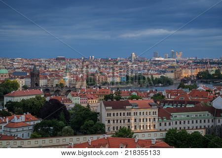View of buildings at Mala Strana (Lesser Town), Old Town and beyond in Prague, Czech Republic, viewed slightly from above at dusk.