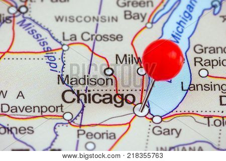 Close-up of a red pushpin on a map of Chicago, USA