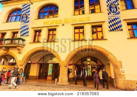Munich, Germany - December 26, 2016: Downtown street view with famous Hofbrauhouse tavern and people