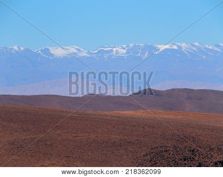 High ATLAS MOUNTAINS range landscape in central MOROCCO seen from location near Zagora city in central part of country, clear blue sky in 2017 warm sunny winter day, northern Africa on February.