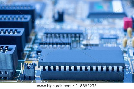 On board are capacitors resistors slots integrated circuits diodes microprocessor.