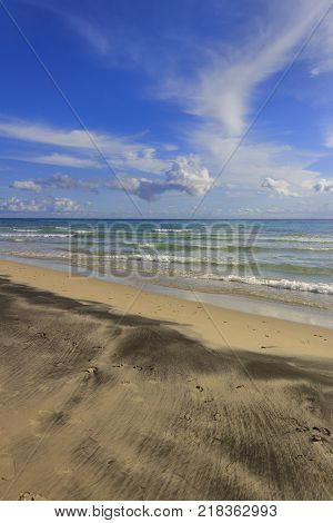 The most beautiful sandy beaches of Apulia.Salento coast: Alimini Beach,ITALY (Lecce). Italy. Horizon dominated by clouds.