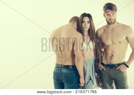 Woman In Sexy Bra With Men With Bare Torsos