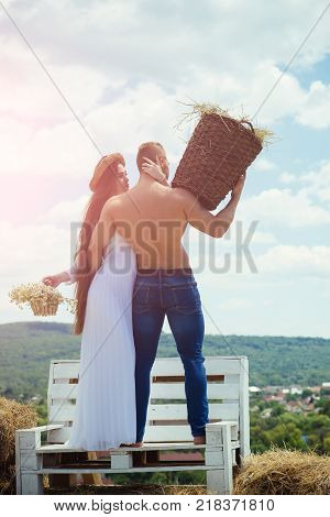 Girl And Macho With Muscular Torso On Nature